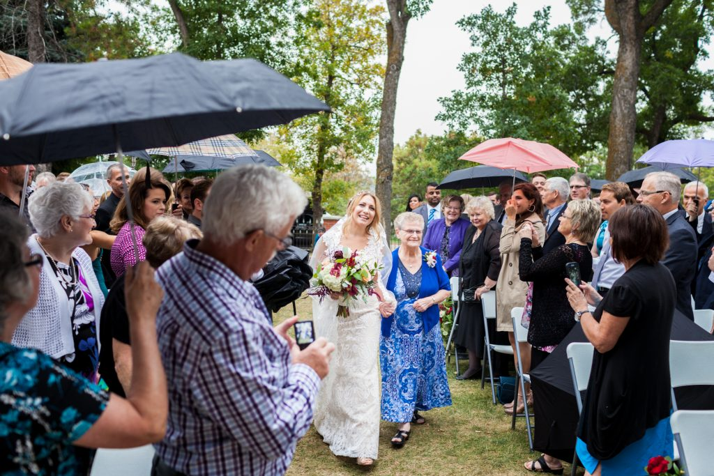 Brides first look at groom during outdoor wedding ceremony edmonton