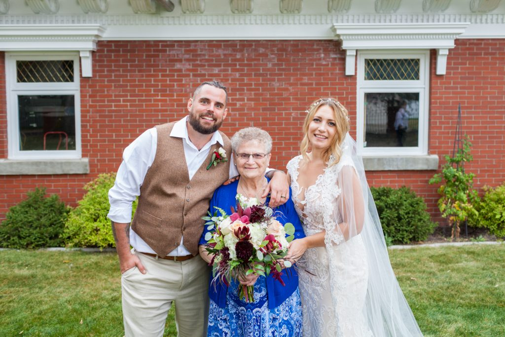 wedding portrait with bride and groom and grandmother
