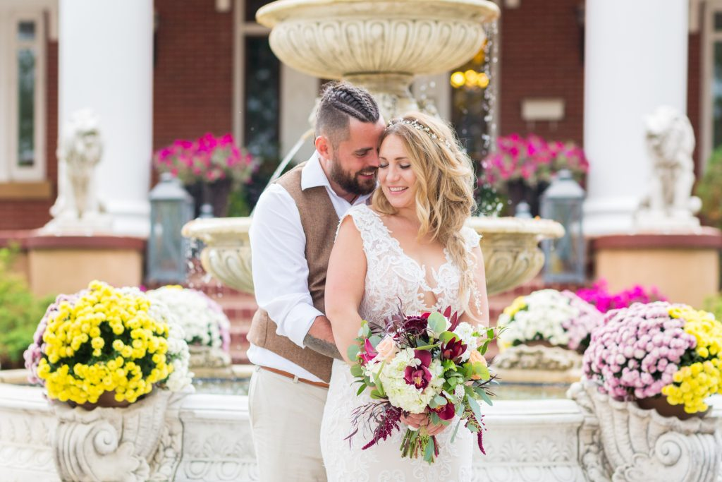 wedding portrait in front of fountain at magrath mansion