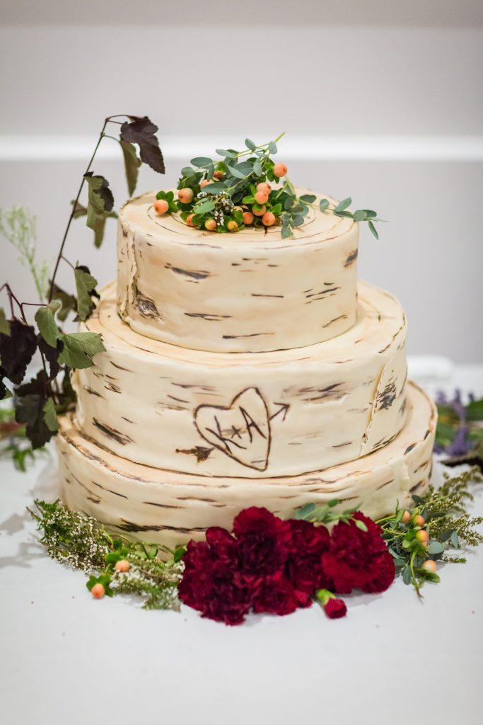 outdoor themed wedding cake that looks like cut logs