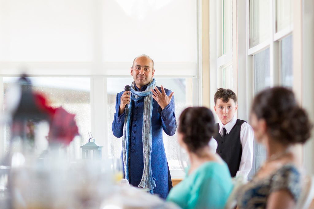 Grooms toast to the bride during Moonlight Bay Centre wedding reception
