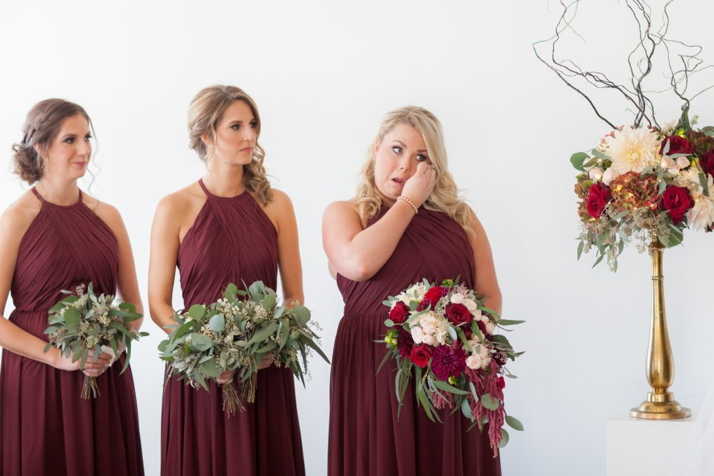 Emotional bridesmaids during Edmonton Shaw Conference Centre wedding ceremony