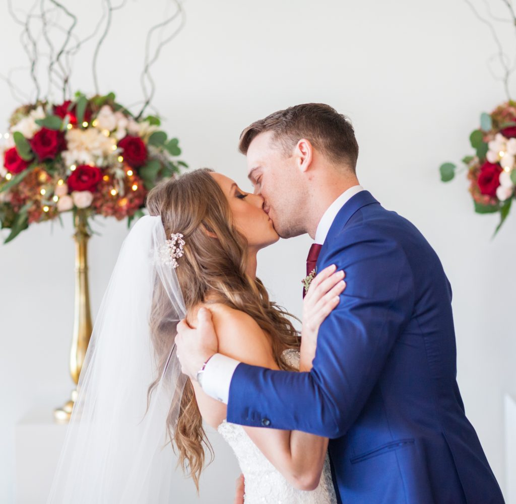 Bride and groom first kiss during their Shaw Conference Centre wedding