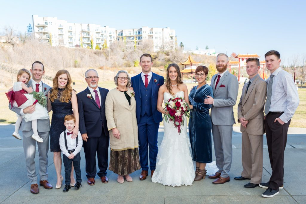 Family wedding photos at Louise McKinney Park near the Shaw Conference Centre