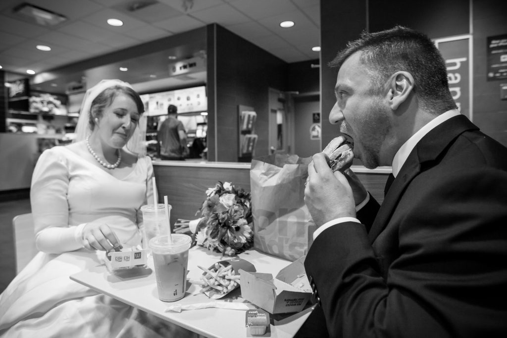 Bride and groom at MacDonalds after St Thomas More wedding ceremony