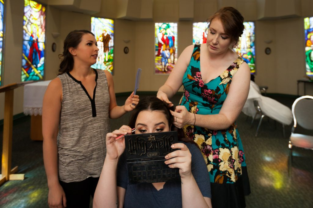 Bride and bridesmaids getting ready at St Thomas More Church before the wedding ceremony