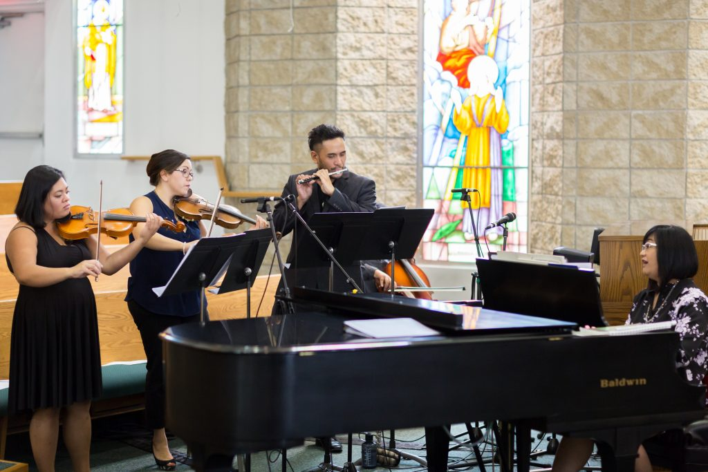 Live musicians play during St Thomas More Church wedding ceremony