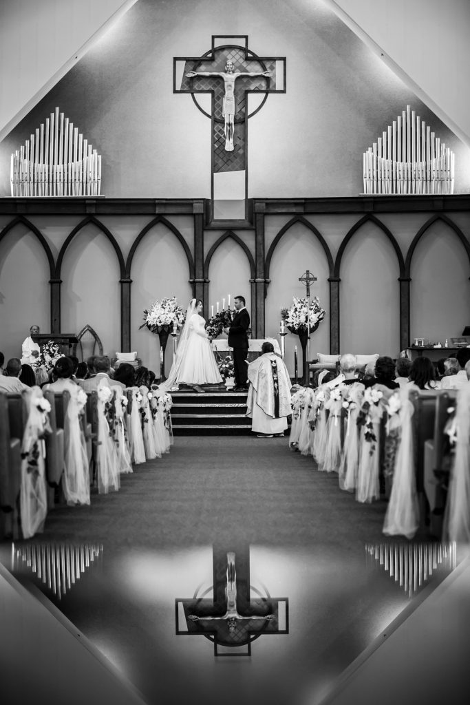 Creative wedding ceremony photos taken at St Thomas More Church in Edmonton