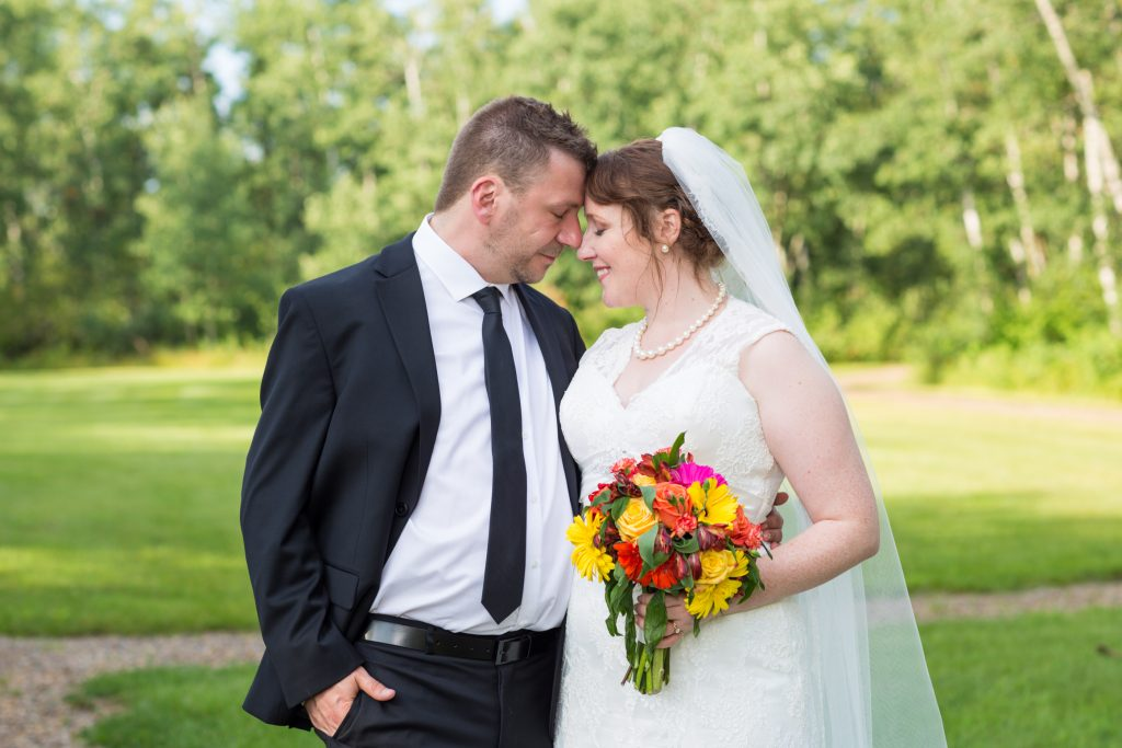 Outdoor wedding portraits in Nisku following the St Thomas More Church ceremony