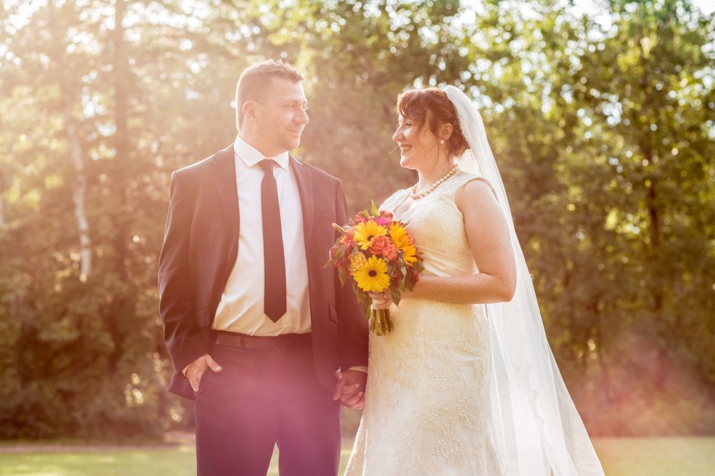 St Thomas More Church wedding portraits taken at sunsete
