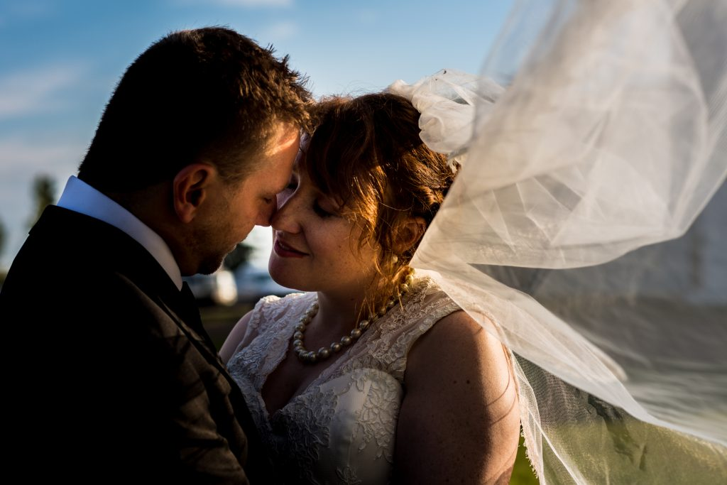 Romantic sunset wedding portraits following St Thomas More Church wedding ceremony