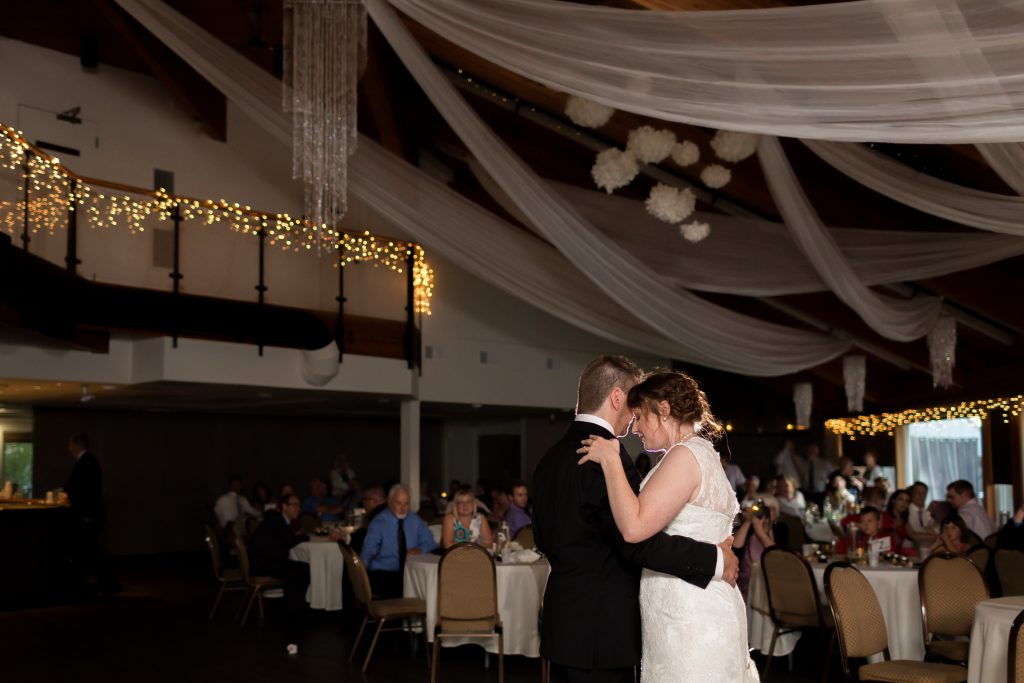 After their St Thomas More Church wedding ceremony, the bride and groom shared their first dance during the wedding reception
