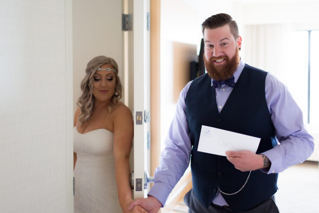 Bride and groom exchange love letters before their summer wedding ceremony at Snow Vally