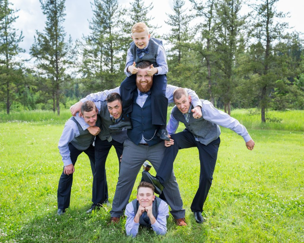 Groomsmen group photo taken at Snow Valley after the wedding ceremony