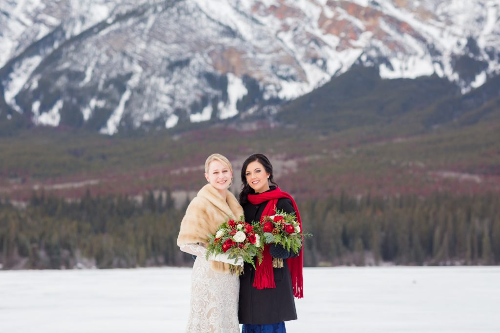 Bride and maid of honour portraits taken in front of the mountains at Pyramid Lake