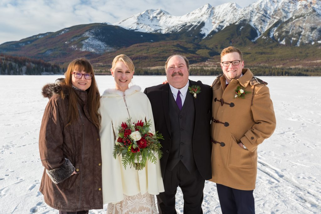 Family portraits on Pyramid lake during winter wedding
