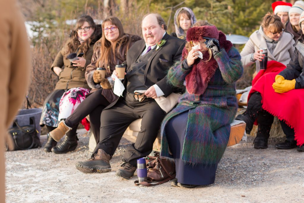 Candid emotional wedding photos of the family watching wedding ceremony at Pyramid Lake
