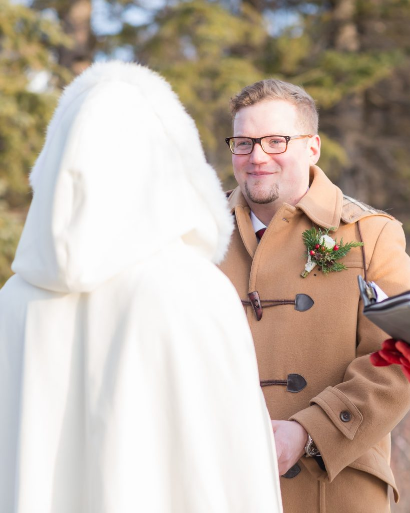 Groom during outdoor wedding ceremony at Pyramid Lake in the winter
