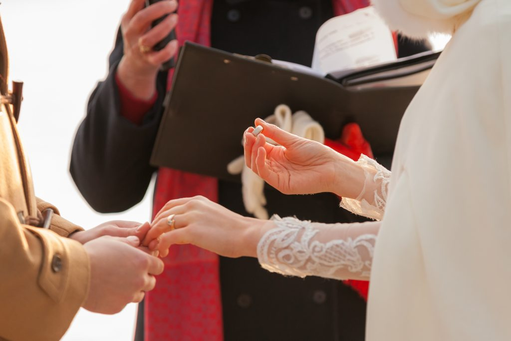 Ring exchange on Pyramid Lake Island during wedding ceremony