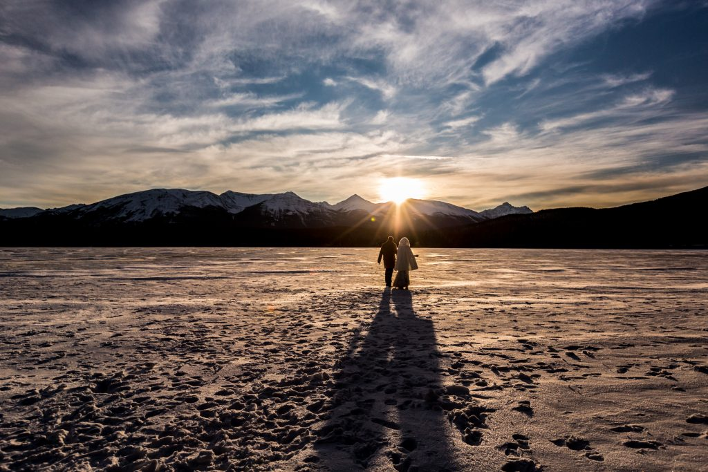 Sunset wedding ceremony on Pyramid Island in Jasper National Park