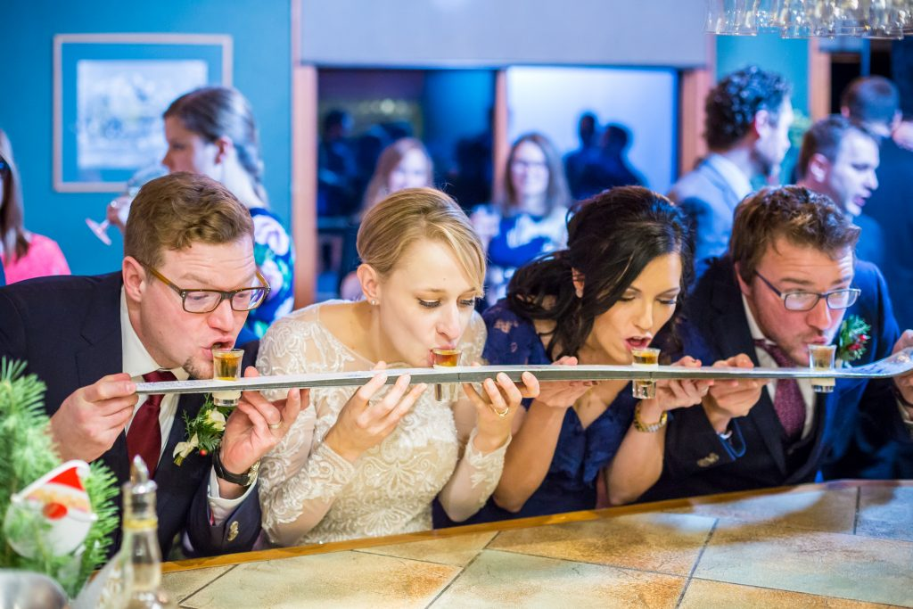 Wedding party with a shot-ski during wedding reception at Pyramid Lake Lodge