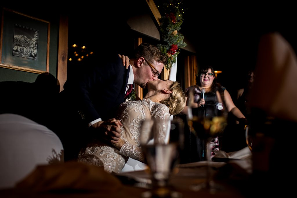 Bride and groom participate in the kissing game during their reception at Pyramid Lake