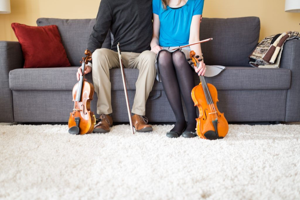 Edmonton in home engagement photos with violins