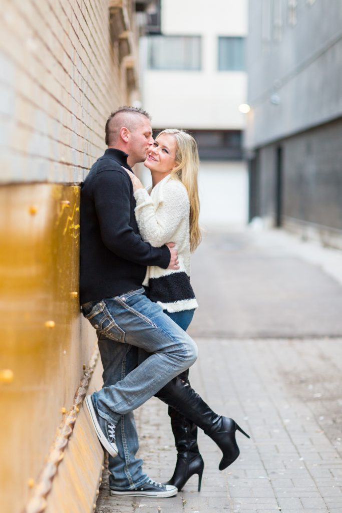Engagement photos taken in Edmonton alleyway
