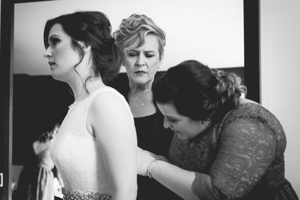 Bride getting dressed before her Mosaic Centre Wedding portraits