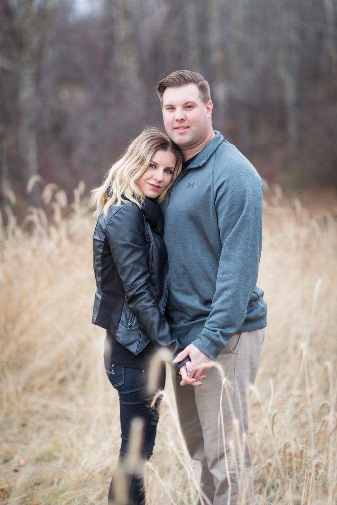 Strathcona science park engagement photos with couple standing in the tall grass