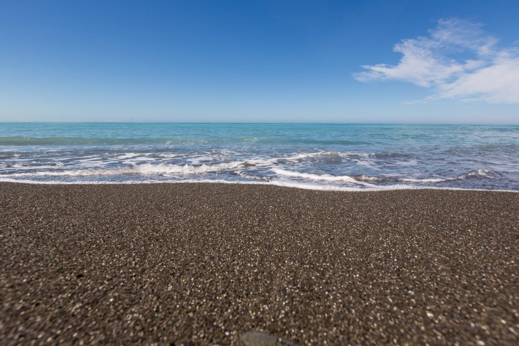 New zealand black sand beach picture