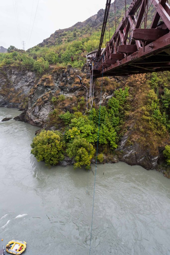 Bungy jumper mid-flight off the Kawarau Gorge Suspension Bridge
