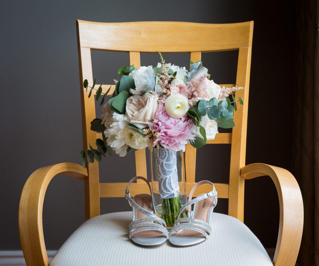 Brides shoes and bouquet