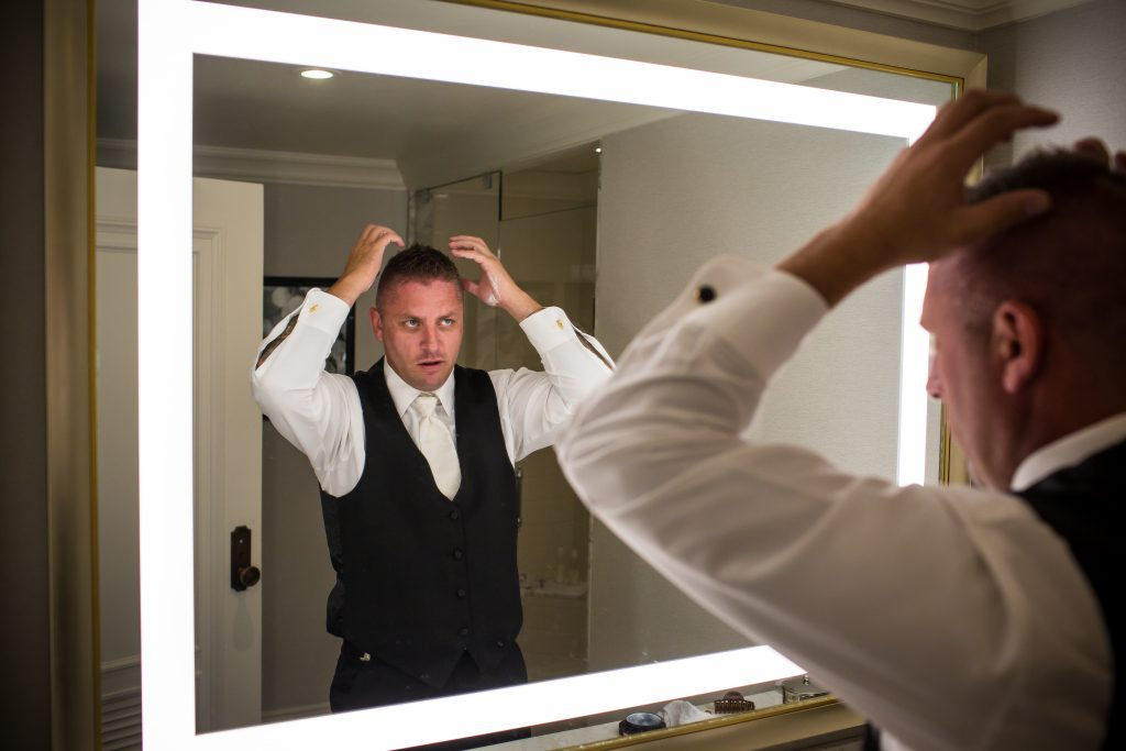 Groom getting ready for wedding ceremony at Fairmont Hotel MacDonald