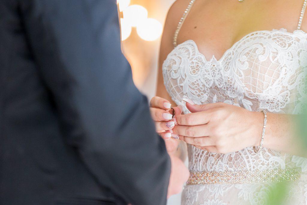 Ring exchange during romantic wedding