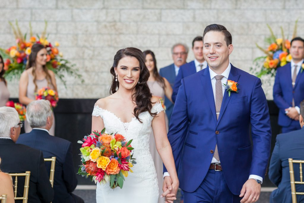 Recessional photos of bride and groom
