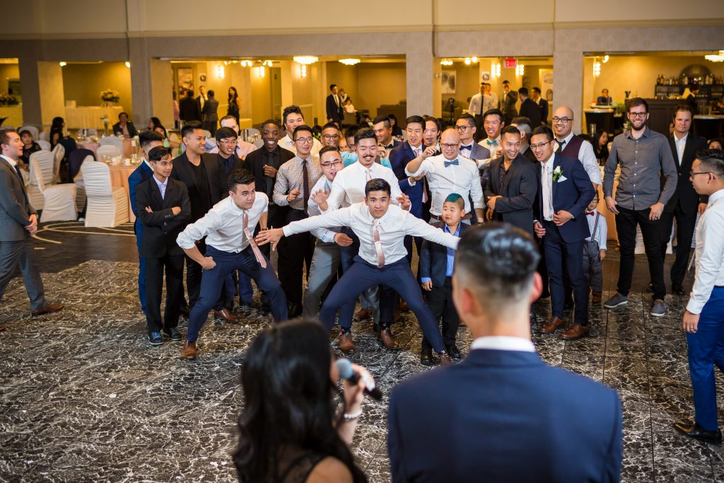 groomsmen waiting for garter toss