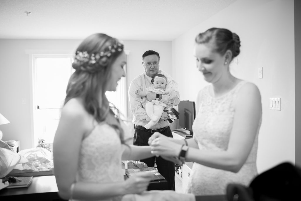 Bride and her sister getting ready