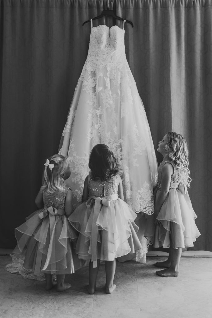 Flowergirls with the wedding dress