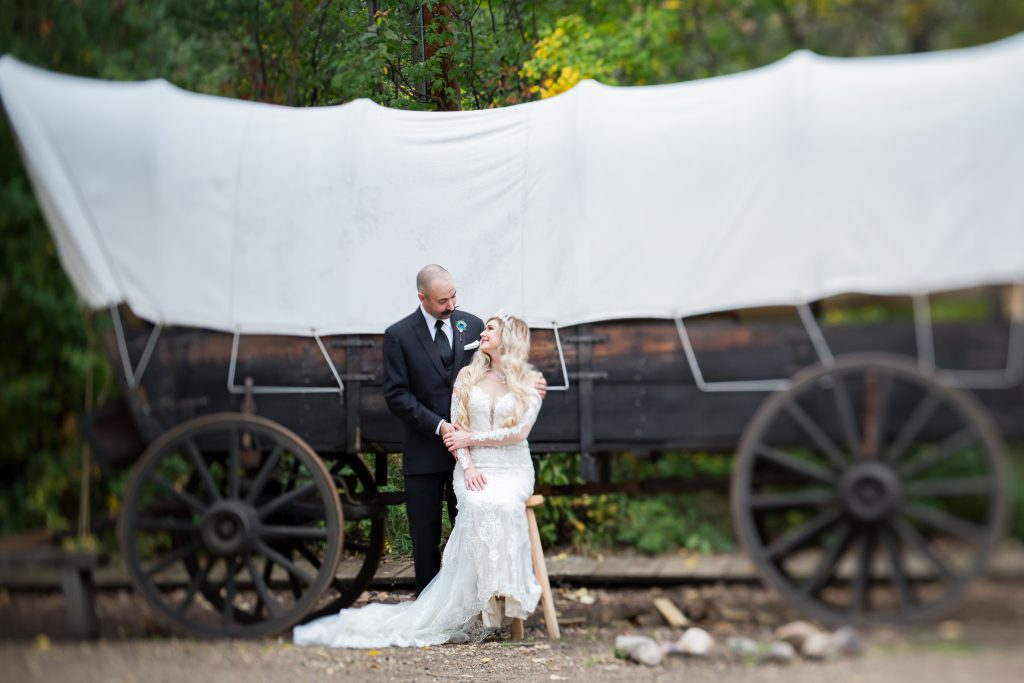 wedding portrait with covered wagon