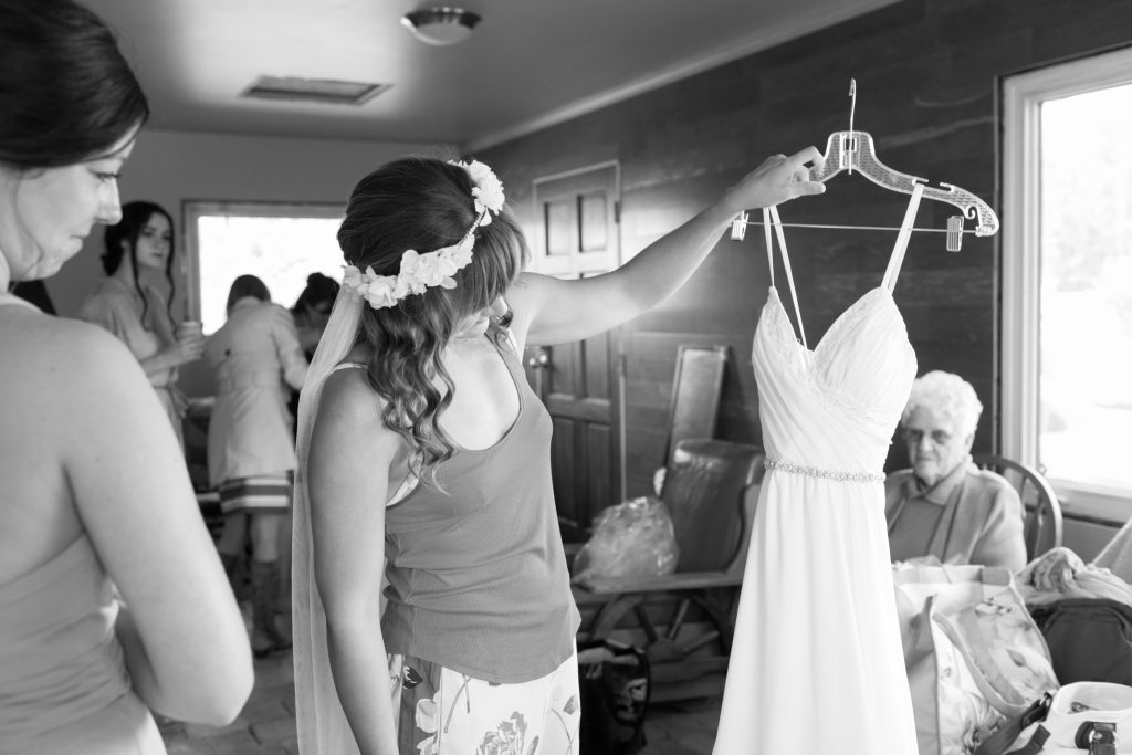 photo of bride and her wedding dress