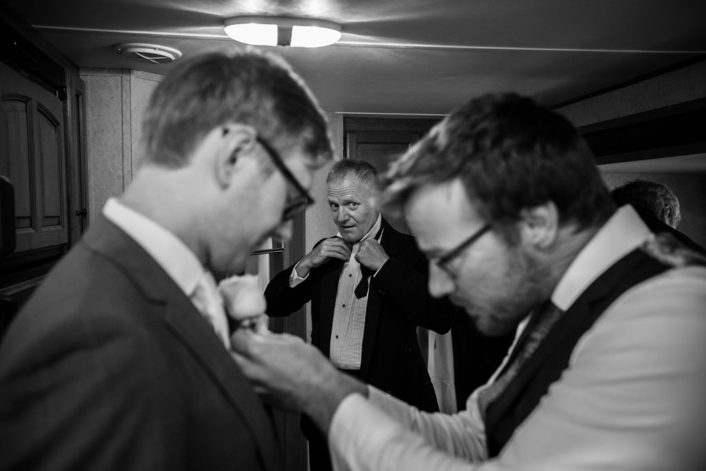groom and father getting ready