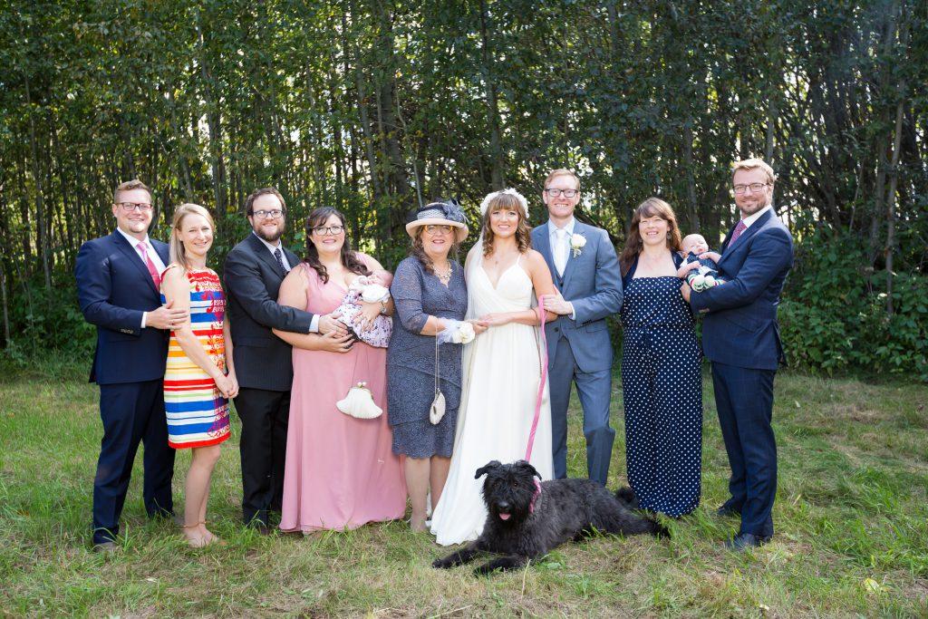 large family portrait at wedding