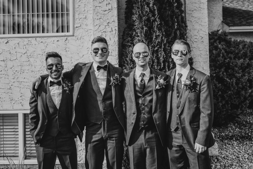 groom with his groomsmen before the wedding