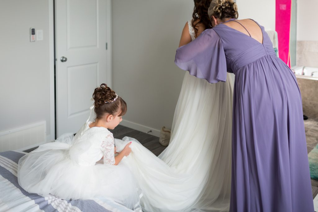 bride getting her wedding dress on