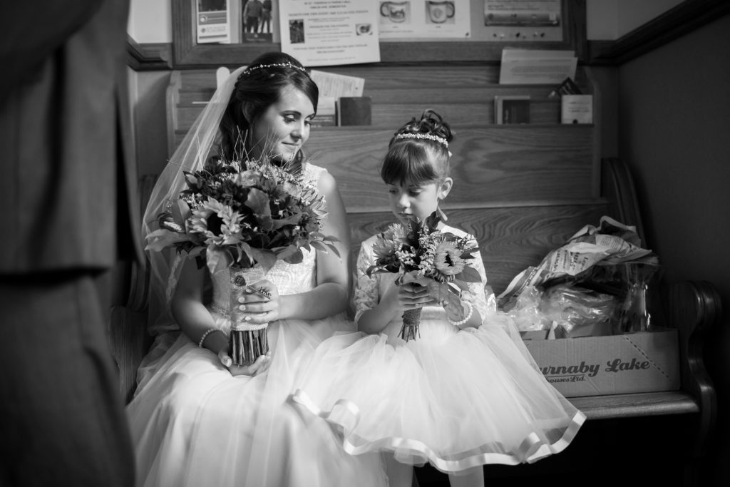quiet moment for bride and flower girl