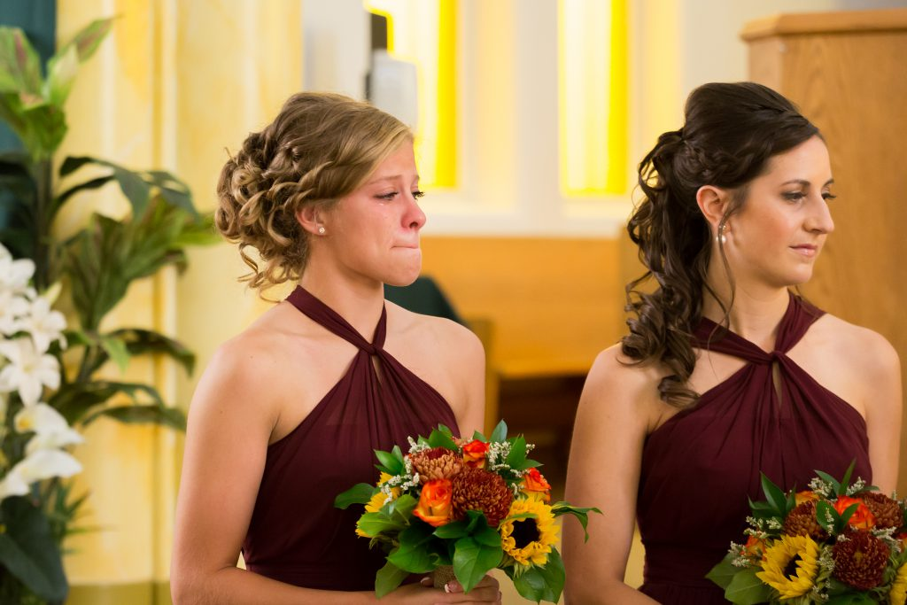 emotional bridesmaid during ceremony