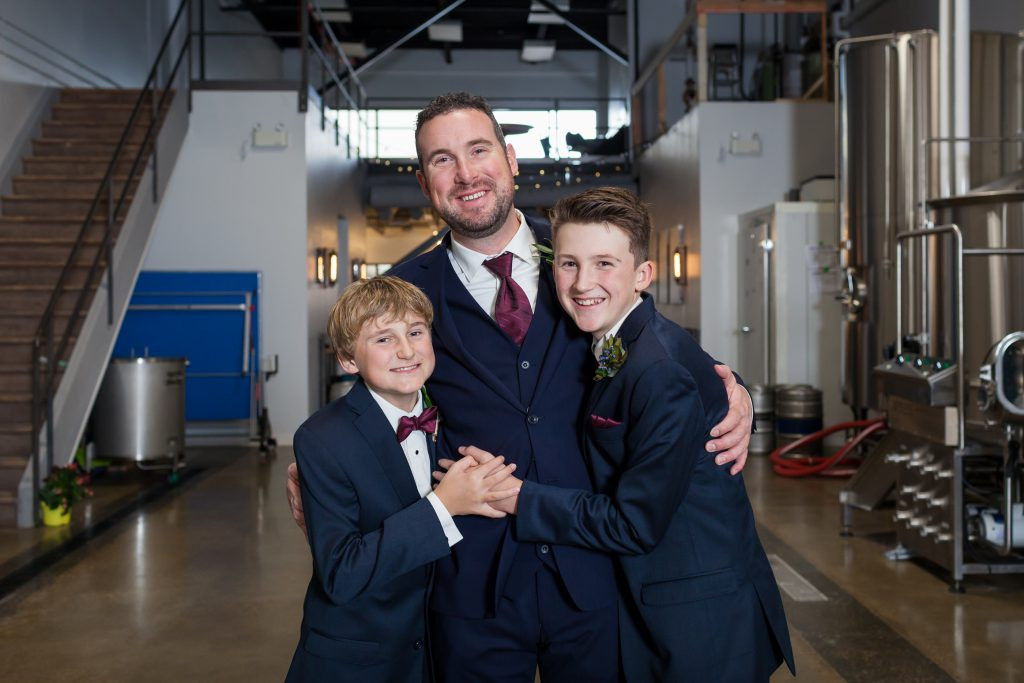 wedding photo of father with sons
