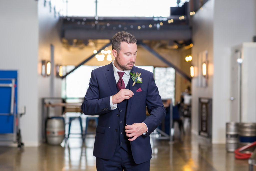 navy and burgundy groom wedding suit