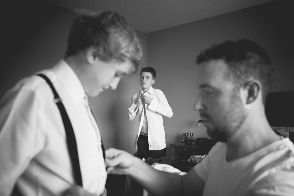 groom and sons getting ready